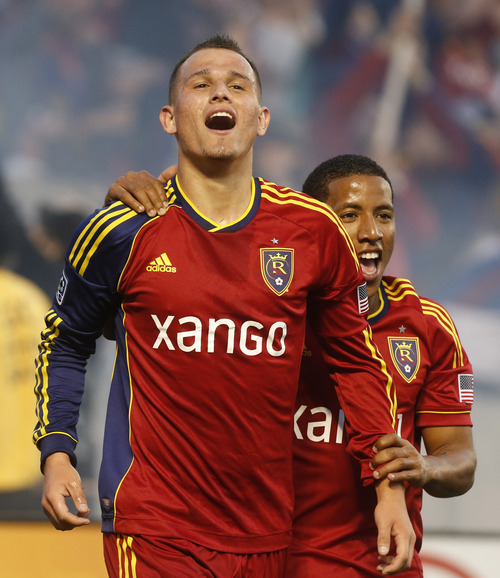 Rick Egan  | The Salt Lake Tribune   Real Salt Lake forward Jou Plata (8) grabs   Luis Gil (21) as they celebrate Gil's goal, giving Salt Lake a  2-0 lead, as Real Salt Lake took on the Seattle Sounders, Saturday, March 30, 2013.