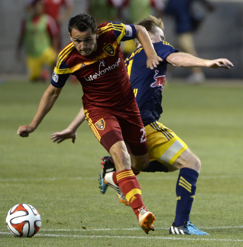 Rick Egan  |  The Salt Lake Tribune  Real Salt Lake midfielder Luis Gil (21) collides with New York Red Bulls midfielder Dax McCarty (11), in MLS action at Rio Tinto Stadium, Wednesday, July 30, 2014