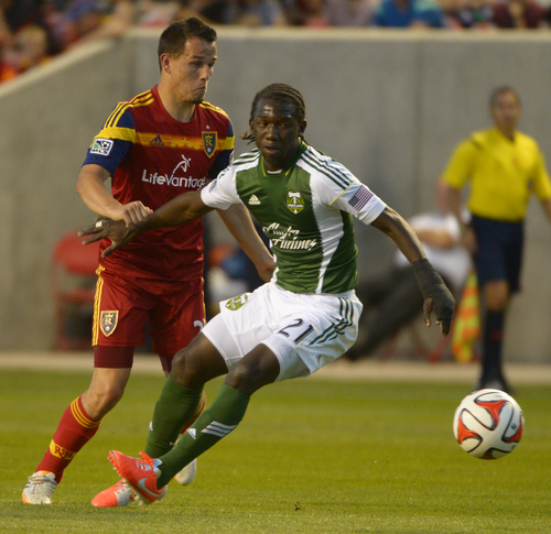 Rick Egan  |  The Salt Lake Tribune  Real Salt Lake midfielder Luis Gil (21) defends, as Portland Timbers midfielder Diego Chara (21) goes for the ball, in MLS soccer action at Rio Tinto stadium, Saturday, June 7, 2014