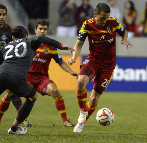 Rick Egan  |  The Salt Lake Tribune  Real Salt Lake midfielder Luis Gil (21) brings the ball upfield, as Toronto's Issey Nakajima-Farran in MLS action, Real Salt Lake vs. Toronto FC, at Rio Tinto Stadium, Saturday, March 29, 2014