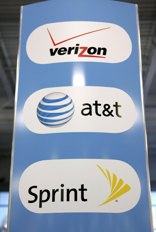 FILE - This April 11, 2011 file photo shows an sign for Verizon, AT&T, and Sprint mobile phones at a Best Buy store in San Francisco. Whether or not you're still on an unlimited plan, you'll have similar things to consider when your phone contract expires. (AP Photo/Jeff Chiu, File)