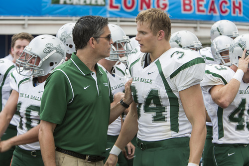 """Coach Bob Ladouceur (Jim Caviezel, left) confronts his star running back, Chris Ryan (Alexander Ludwig), during a game in the sports drama """"When the Game Stands Tall."""" Tracy Bennett  