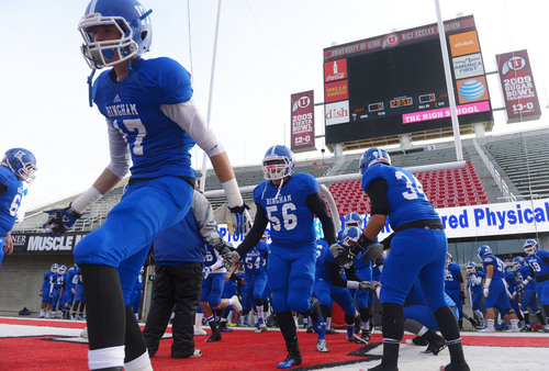 Steve Griffin  |  The Salt Lake Tribune   Bingham players take the field prior to the start of the 5A championship football game between Bingham and Brighton at Rice Eccles Stadium in Salt Lake City, Utah Friday, November 22, 2013.