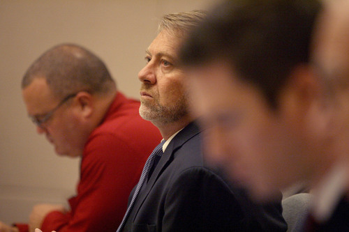 Uintah County Attorney G. Mark Thomas listens to jury instructions before presenting his closing argument Friday, Aug. 22, 2014, in the murder trial for Jesse Anthony Saenz. Saenz, 24, is accused of killing 22-year-old Elvis Zachary Olsen on April 21, 2013, and stealing his car.