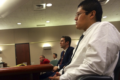 Jesse Anthony Saenz, right, and defense attorney Ryan Holtan listen to Uintah County Attorney G. Mark Thomas present his argument Friday, Aug. 22, 2014, in Saenz's murder trial. Saenz, 24, is accused of killing 22-year-old Elvis Zachary Olsen on April 21, 2013, and stealing his car.