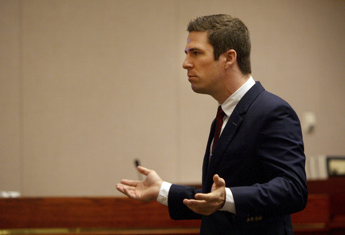 Defense attorney Ryan Holtan addresses the jury during closing arguments Friday, Aug. 22, 2014, in the murder trial for Jesse Anthony Saenz. Saenz, 24, is accused of killing 22-year-old Elvis Zachary Olsen on April 21, 2013, and then stealing Olsen's car.