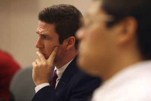 Defense attorney Ryan Holtan listens to jury instructions before presenting his closing argument Friday, Aug. 22, 2014, in the murder trial for Jesse Anthony Saenz. Saenz, 24, is accused of killing 22-year-old Elvis Zachary Olsen on April 21, 2013, and stealing his car.