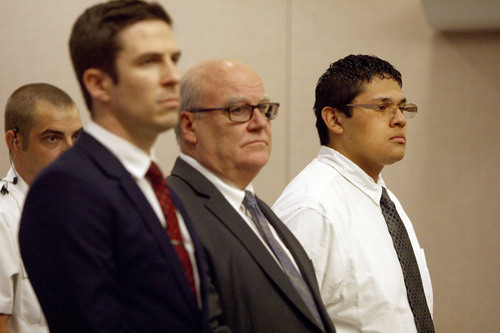 Jesse Anthony Saenz, far right, stands with his defense attorneys as 8th District Judge Clark McClellan reads the guilty verdicts to charges of murder, theft and possession of a dangerous weapon by a restricted person Friday, Aug. 22, 2014. Saenz, 24, was convicted of killing 22-year-old Elvis Zachary Olsen, a jailhouse acquaintance, on April 21, 2013, and then stealing his car.