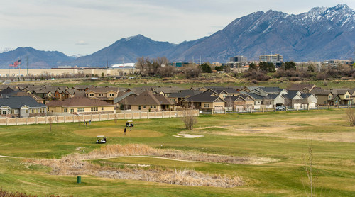 Trent Nelson  |  The Salt Lake Tribune South Jordan residents are attempting to save Mulligans Golf Course and the open space it sits on, all owned by South Jordan, from development. Golfers played the course near an adjacent development Saturday March 29, 2014.