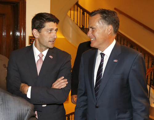 "Former Massachusetts Gov. Mitt Romney, , right and his former vice presidential running mate U.S. Rep. Paul Ryan, R-Wis., arrive for a dinner at the Union Club where Romney will interview Ryan's about Ryan's new book, ""The Way Forward: Renewing the American Idea."" Thursday, Aug. 21, 2014, in Chicago. Ryan is on tour to promote the book as he weighs a presidential campaign of his own. (AP Photo/Charles Rex Arbogast)"
