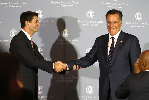 "Former Massachusetts Gov. Mitt Romney, right, shakes hands with his former vice-presidential running mate U.S. Rep. Paul Ryan, R-Wis., before Romney interviews Ryan about Ryan's new book, ""The Way Forward: Renewing the American Idea,"" during an event at the Union League Club Thursday, Aug. 21, 2014, in Chicago. Ryan is on tour to promote the book as he weighs a presidential campaign of his own. (AP Photo/Charles Rex Arbogast)"