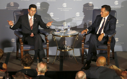"Former Massachusetts Gov. Mitt Romney, right, listens to the response of his former vice-presidential running mate U.S. Rep. Paul Ryan, R-Wis., during an interview about Ryan's new book, ""The Way Forward: Renewing the American Idea."" during an event at the Union League Club Thursday, Aug. 21, 2014, in Chicago. Ryan is on tour to promote the book as he weighs a presidential campaign of his own. (AP Photo/Charles Rex Arbogast)"