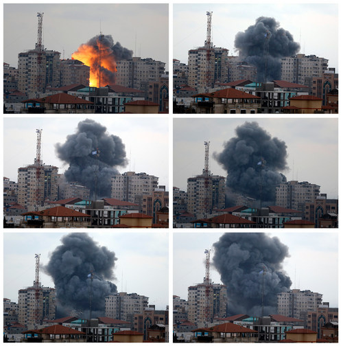 In this combination photo composed of six frames, the Al-Zafer apartment tower block collapses following Israeli airstrikes in Gaza City, in the northern Gaza Strip, Saturday, Aug. 23, 2014. Israeli aircraft fired two missiles at a 12-story apartment tower in downtown Gaza City on Saturday, collapsing the building, sending a huge fireball into the sky and wounding at least 22 people, including 11 children, witnesses and Palestinian officials said. (AP Photo/Adel Hana)