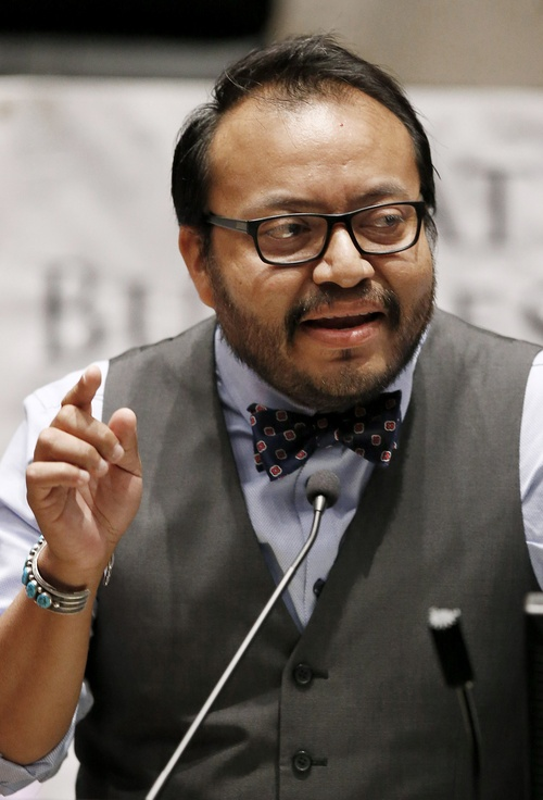 In this Friday, Aug. 1, 2014 photo, Moroni Benally answers a question at the Navajo Nation presidential candidate debate in Tempe, Ariz. Benally is one of 17 candidates in the Tuesday, Aug. 26, 2014 primary election for Navajo Nation president. (AP Photo/Ross D. Franklin)