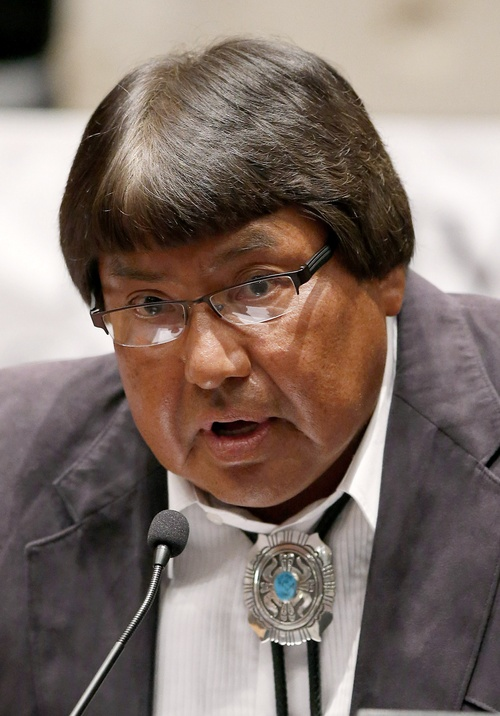 """In this Friday, Aug. 1, 2014 photo, Edison """"Chip"""" Begay answers a question at the Navajo Nation presidential candidate debate in Tempe, Ariz. Begay is one of 17 candidates in the Tuesday, Aug. 26, 2014 primary election for Navajo Nation president. (AP Photo/Ross D. Franklin)"""