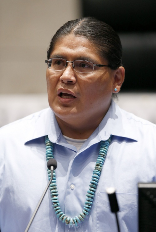 In this Friday, Aug. 1, 2014 photo, Chris Deschene addresses the audience at the Navajo Nation presidential candidate debate in Tempe, Ariz. Deschene is one of 17 candidates in the Tuesday, Aug. 26, 2014 primary election for Navajo Nation president. (AP Photo/Ross D. Franklin)