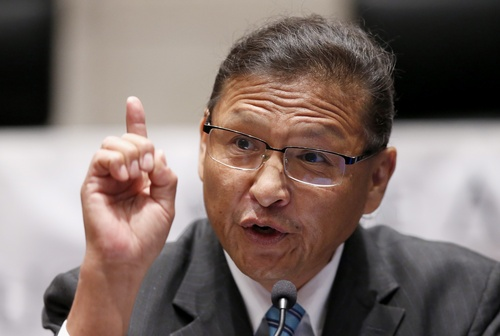 In this Friday, Aug. 1, 2014 photo, Cal Nez speaks at the Navajo Nation presidential candidate debate in Tempe, Ariz. Nez is one of 17 candidates in the Tuesday, Aug. 26, 2014 primary election for Navajo Nation president. (AP Photo/Ross D. Franklin)