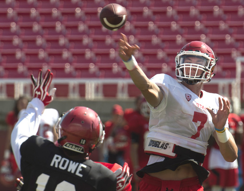 Rick Egan  |  The Salt Lake Tribune  Defensive back, Eric Rowe, tries to get a hand up, as Ute QB, Travis Wilson throws a pass, during practice at Rice Eccles Stadium, Wednesday, August 6, 2014