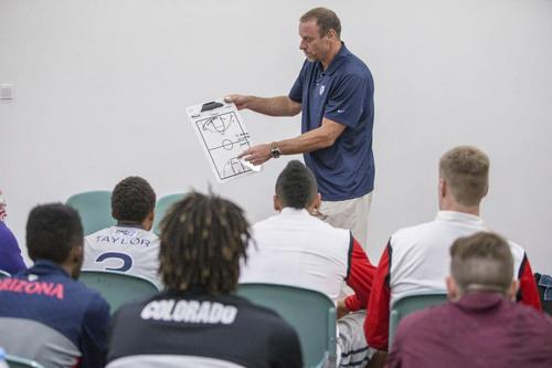 Kory Mortensen  |  Utah Athletics  Utah head coach Larry Krystkowiak addresses his team of Pac-12 All-Stars in Shanghai.