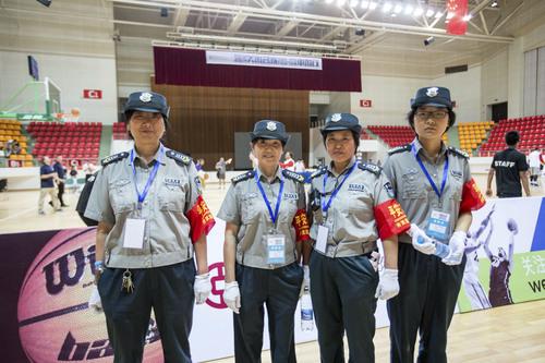 Kory Mortensen  |  Utah Athletics  Staffers work a Pac-12 All-Stars game in Shanghai.