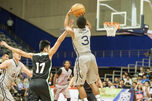 Kory Mortensen  |  Utah Athletics  Utah point guard Brandon Taylor puts up a shot in Shanghai.