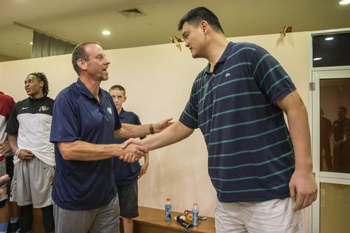 Kory Mortensen  |  Utah Athletics  Utah head coach Larry Krystkowiak meets with former Houston Rockets all-star and current Shanghai Sharks team president Yao Ming.