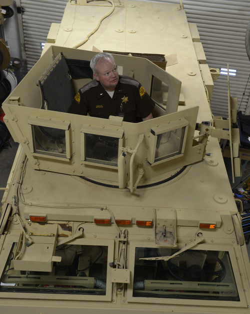 Rick Egan  | The Salt Lake Tribune   Lt. Alex Lepley stands inside a mine-resistant vehicle (MRAP)  is being fixed up for duty at the UHP maintenance shop in Taylorsville, Monday, January 13, 2014.