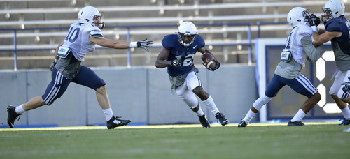 Chris Detrick  |  The Salt Lake Tribune Brigham Young Cougars wide receiver Devon Blackmon (12) runs the ball during a scrimmage at LaVell Edwards Stadium Friday August 15, 2014.