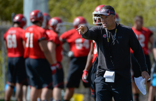 Franciso Kjolseth  |  The Salt Lake Tribune University of Utah head football coach Kyle Whittingham gets his team ready for the season during Spring no pads practice at the Spence Eccles Football Facility on Thursday, April 17, 2014.