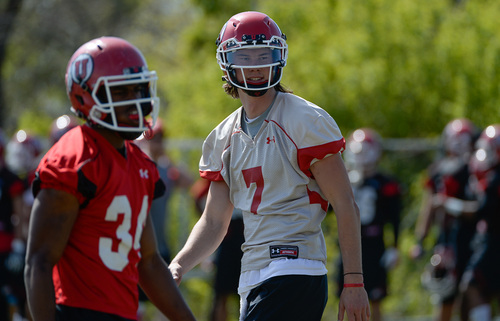 Franciso Kjolseth  |  The Salt Lake Tribune University of Utah quarterback Travis Wilson works out with the team as they get gets ready for the season during Spring practice at the Spence Eccles Football Facility on Thursday, April 17, 2014.