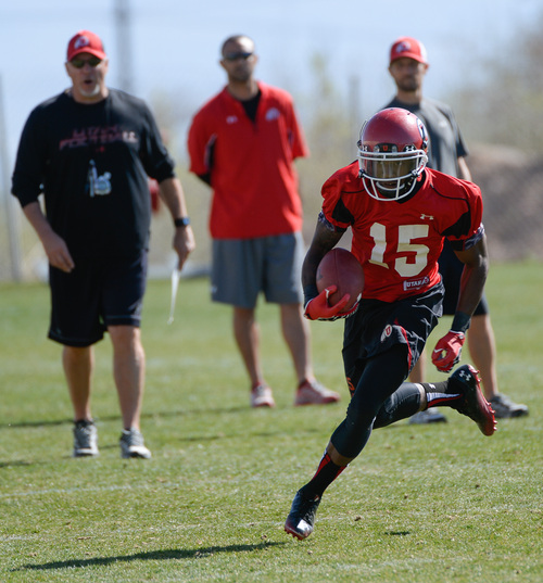 Franciso Kjolseth  |  The Salt Lake Tribune Dominique Hatfield runs the ball as the University of Utah football team gets ready for the season during Spring practice at the Spence Eccles Football Facility on Thursday, April 17, 2014.
