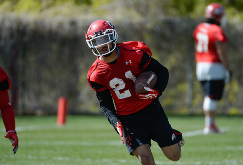 Franciso Kjolseth  |  The Salt Lake Tribune Troy McCormick runs the ball as the University of Utah football team gets ready for the season during Spring practice at the Spence Eccles Football Facility on Thursday, April 17, 2014.