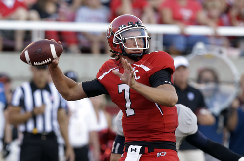 FILE - In this Aug. 29, 2013, file photo, Utah's Travis Wilson passes the ball against Utah State during an NCAA college football game in Salt Lake City.   Utah has gone 5-7 in each of the past two seasons as the team has transitioned to the more competitive Pac-12, which the Utes joined in 2011.   (AP Photo/Rick Bowmer, File)