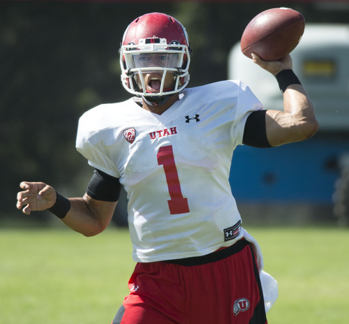 Steve Griffin  |  The Salt Lake Tribune   University of Utah quarterback Kendal Thompson drops back to throw during football practice on the University of Utah baseball field in Salt Lake City, Monday, August 18, 2014.