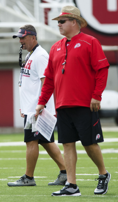 Steve Griffin  |  The Salt Lake Tribune  Utah head football coach Kyle Whittingham, left, and offensive coordinator Dave Christensen watch the offense during football practice at Rice-Eccles Stadium in Salt Lake City Monday, Aug. 4, 2014.
