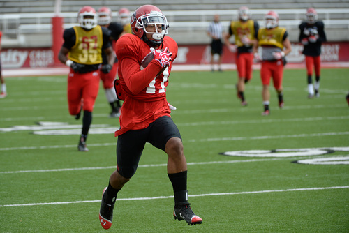 Francisco Kjolseth     The Salt Lake Tribune Wide receiver Kaelin Clay of the University of Utah football team leaves the defense behind during practice at Rice-Eccles Stadium on Tuesday morning, Aug. 12, 2014.