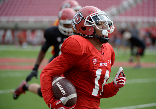 Francisco Kjolseth  |  The Salt Lake Tribune Wide receiver Kaelin Clay of the University of Utah football team leaves the defense behind during practice at Rice-Eccles Stadium on Tuesday morning, Aug. 12, 2014.