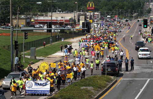 Members of the St. Louis chapters of the NAACP and the National Urban League march on West Florissant Avenue in Ferguson, Mo., on Saturday, Aug. 23, 2014. Ferguson's streets remained peaceful as tensions between police and protesters continued to subside after nights of violence and unrest that erupted when Officer Darren Wilson, a white police officer, fatally shot Michael Brown, an unarmed black 18-year-old. (AP Photo/St. Louis Post-Dispatch, Robert Cohen)