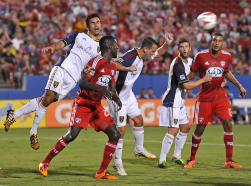 Real Salt Lake's Tony Beltran (2) leaps onto FC Dallas' Je-Vaughn Watson (27) as Luis Gil heads the ball away in front of Chris Wingert, second from right, and Tesho Akindele (13) during an MLS soccer game Friday, Aug. 22, 2014, in Frisco, Texas. Dallas won 2-1. (AP Photo/The Dallas Morning News, Mark M. Hancock)