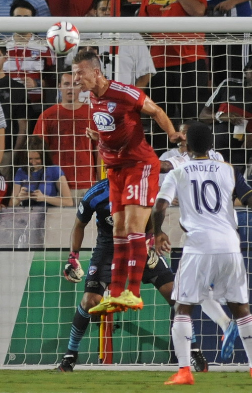 FC Dallas' Michel (31) defends with a header in front of goalkeeper Raul Fernandez (1) as Real Salt Lake's Robbie Findley (10) watches during an MLS soccer game Friday, Aug. 22, 2014, in Frisco, Texas. FC Dallas won 2-1. (AP Photo/The Dallas Morning News, Mark M. Hancock)
