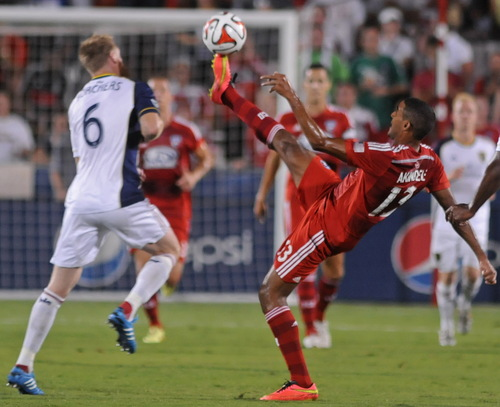 FC Dallas' Tesho Akindele (13) kicks the ball away from Real Salt Lake's Nat Borchers (6) during an MLS soccer game Friday, Aug. 22, 2014, in Frisco, Texas. FC Dallas won 2-1. (AP Photo/The Dallas Morning News, Mark M. Hancock)