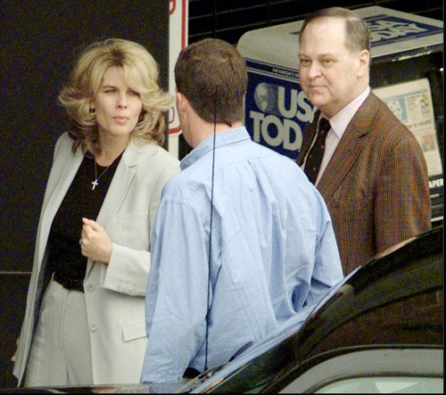 This photo taken April 7, 1998 shows Frederick Koch, right, along with his sister-in-law Angela Koch, left, talking to the driver of their car before entering the federal courthouse in Topeka,  Kansas. The two were arriving for the second day of jury selection in the trial that has divided the Koch family in two. Bill and Frederick Koch are suing their brothers Charles and David for more than a  billion dollars. The Kochs are demonized by Democrats, who lack a liberal equal to counter their weight, and not entirely understood by Republicans, who benefit from their seemingly limitless donations.  (AP Photo/Travis Heying, The Wichita Eagle)