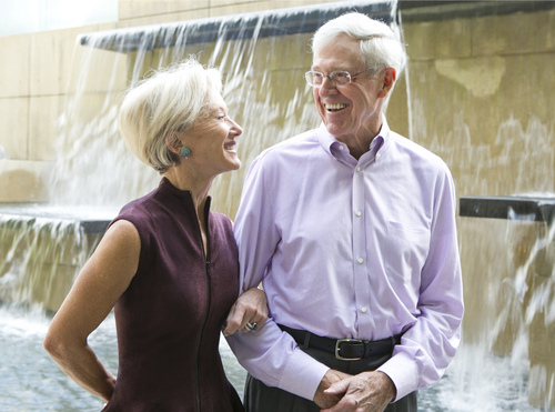 This photo taken Sept. 26, 2012 shows Charles and Liz Koch at Koch Headquarters in Wichita, Kansas. The Kochs are demonized by Democrats, who lack a liberal equal to counter their weight, and not entirely understood by Republicans, who benefit from their seemingly limitless donations. Married 44 years Liz says she is the only one that has cut his hair since they've been married.  (AP Photo/The Wichita Eagle, Bo Rader)