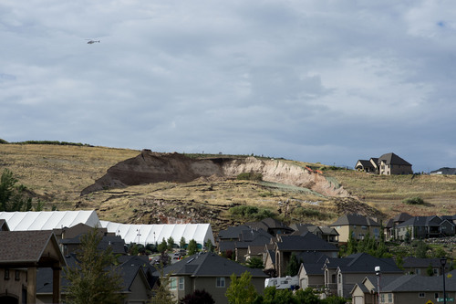 Jeremy Harmon     The Salt Lake Tribune  A huge scar from a landslide is seen above Parkway Drive in North Salt Lake on Tuesday, August 5, 2014.