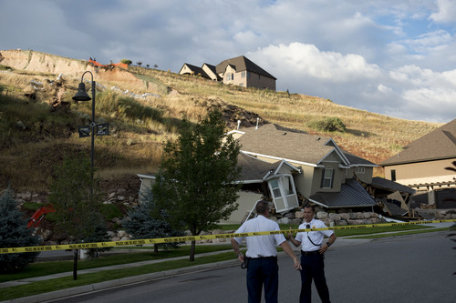 Jeremy Harmon  |  The Salt Lake Tribune  This home at 739 Parkway Drive in North Salt Lake was destroyed by a landslide on Tuesday, Aug. 5, 2014.