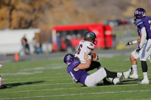 |  Courtesy Weber State Athletics  Anthony Morales making a tackle during the 2013 Weber State vs. Southern Utah University football game.
