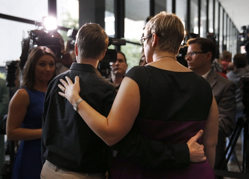 Tara Betterman-Layne, left, and her wife Melody Betterman-Layne, both from Indianapolis, Ind., talk to reporters after attending a hearing before the 7th U.S. Circuit Court of Appeals on the challenges to Indiana and Wisconsin's gay marriage ban Tuesday, Aug. 26, 2014, in Chicago. (AP Photo/Charles Rex Arbogast)