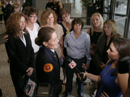 Ruth Morrison, center, a retired Indianapolis Fire Department battalion chief, talks to a reporter after attending a hearing before the 7th U.S. Circuit Court of Appeals on the challenges to Indiana and Wisconsin's gay marriage ban Tuesday, Aug. 26, 2014, in Chicago. Morrison worries that because Indiana won't recognize the woman she married in another state as her wife, she wouldn't be able to pass on pension and other benefits if she dies. (AP Photo/Charles Rex Arbogast)