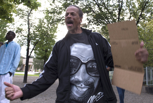 Rick Egan  |  The Salt Lake Tribune  Oscar Ross, shouts along with other protesters, in solidarity with Mike Brown, Dillon Taylor, Danielle Willard and others who they feel were killed unjustly by police. Monday, August 25, 2014.