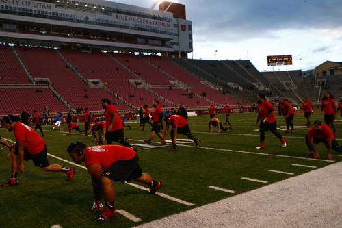 Chris Detrick  |  Tribune file photo Members of the Utah football team warm up before the game at Rice-Eccles Stadium Thursday October 3, 2013.